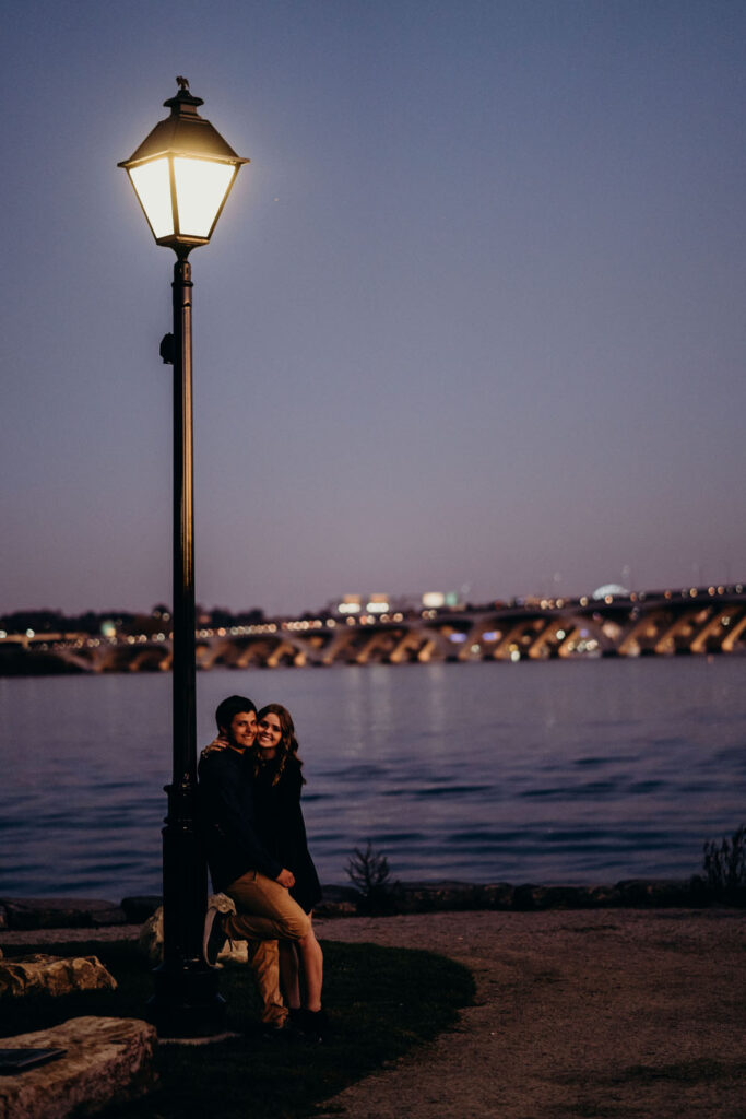Couple have a moment by a streetlight