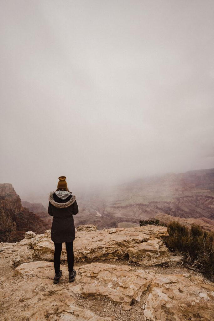 Girl looks at hazy Grand Canyon