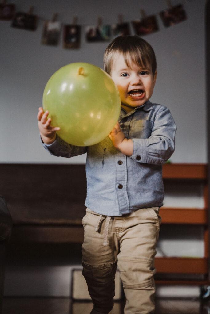 Child holding ballon