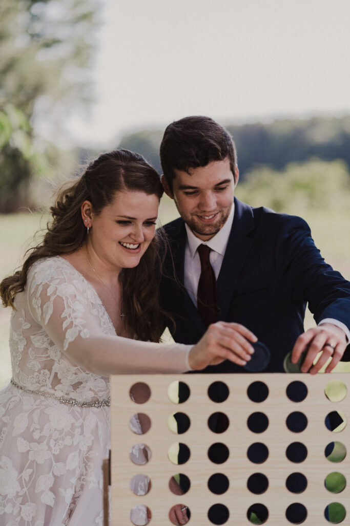 Couple playing connect four in dress and suit