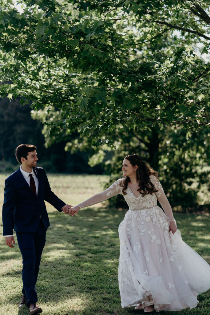 couple walking in wedding clothes