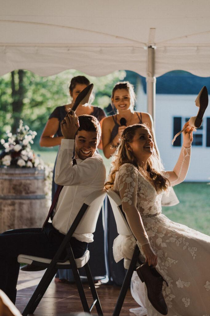 couple raising shoes at wedding